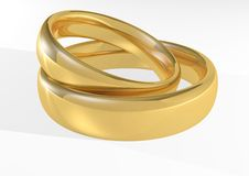 Gold shiny wedding rings Royalty Free Stock Photography