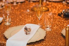Gold shiny wedding table decor for event stock photo
