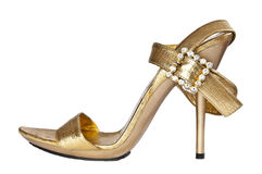 Gold shoe Royalty Free Stock Images