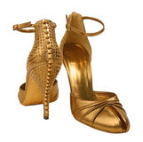 Gold shoes Stock Images