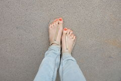 Gold Shoes (Slippers) on Girl  Legs and Feet on the Ground Stock Images