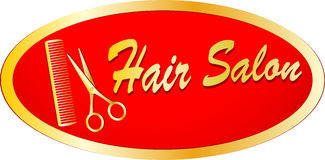 Gold sign of hair salon with scissors and comb Royalty Free Stock Image