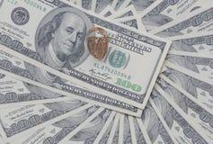 Gold signet on  U.S. dollars. Gold signet on a pile of U.S. dollars Stock Image