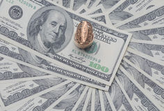 Gold signet on the USD. Gold signet on a pile of U.S. dollars Royalty Free Stock Photos