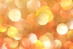 Gold, Silber, Rot, Weiß, orange abstraktes bokeh beleuchtet Lizenzfreie Stockfotos