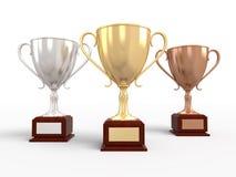 Gold-, Silber- und Bronzentrophäecup Lizenzfreie Stockfotos