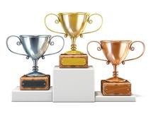 Gold-, Silber- und Bronzesiegertrophäencups 3d übertragen Lizenzfreies Stockbild