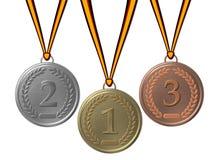 Gold-, silberne und Bronzemedaille Stockbilder
