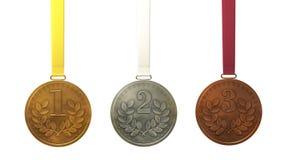 Gold-, silberne und Bronzemedaillen Stockfotografie
