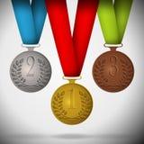 Gold-, silberne und Bronzemedaillen Stockfotos