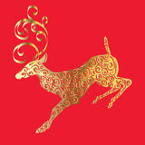 Gold silhouette of deer on red background. Royalty Free Stock Photography