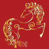 Gold silhouette of a horse. On a red background Royalty Free Stock Photo