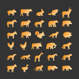 Gold silhouettes of animals on black background. Stock Photography