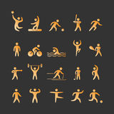 Gold silhouettes of athletes Royalty Free Stock Photography