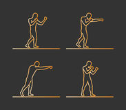 Gold silhouettes of boxing. Royalty Free Stock Photography
