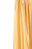 Gold silk drapery. Stock Photos