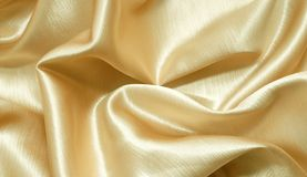 Gold silk fabric. Smooth elegant gold silk fabric Royalty Free Stock Images