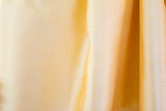 Gold silk fabric texture Stock Images