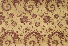 Gold silk with floral pattern Stock Photo