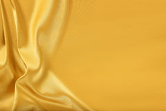 Gold silk satin. Gold silk texture of satin abstract background Stock Photography