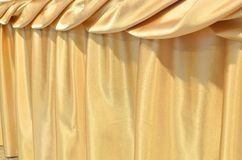 Gold Silk tablecloth background Royalty Free Stock Images