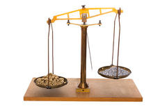 Gold and silver on a balance. Weighing gold and silver nuggets Stock Photos