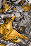 Gold and silver balloon deflated Royalty Free Stock Photography