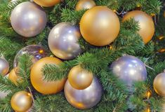 Gold and silver balls on the Christmas tree stock photography