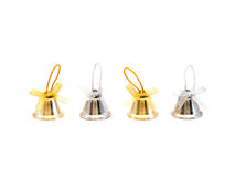 Gold and silver bells. On white background stock photo