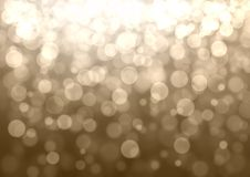 Gold and silver bokeh background. Gold and silver Christmas abstract bokeh glitter lights festive background. Gray beige circle bokeh texture Royalty Free Stock Photos