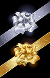 Gold and silver bow. Gold and silver, shiny bow on a dark background Stock Photography