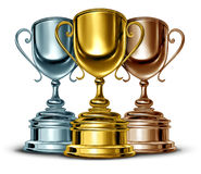 Gold Silver And Bronze. Trophies and trophy award as the best three winners of a sport or sporting competition as a symbol of sportsmanship and success as a Royalty Free Stock Photos