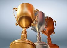 Gold silver bronze. Rendered three cups on blue background royalty free illustration