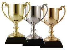 Gold silver and bronze. Trophies arranged on a isolated white background Stock Photo