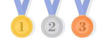 Gold, silver and bronze award medals with ribbons. First, second. And third places Stock Photo