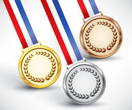 Gold, silver and bronze award medals. Unnumbered gold, silver and bronze medal with tricolor ribbon on white background, vector illustration, eps10 Stock Photos