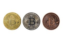 Gold silver and bronze bitcoin coins on white background. Bitcoin coins close-up stock image