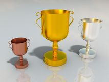 Gold silver and bronze cups for winners Royalty Free Stock Images