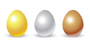 Gold, silver and bronze eggs Royalty Free Stock Image