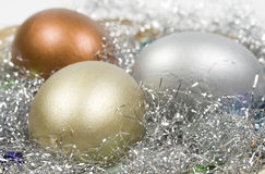 Gold, silver and bronze eggs Stock Photography