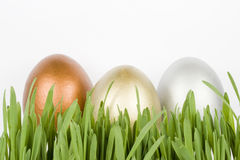 Gold, silver and bronze eggs Royalty Free Stock Photography