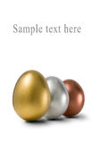 Gold, silver and bronze eggs Royalty Free Stock Images