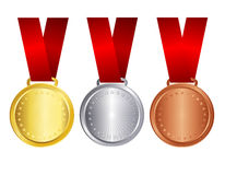 Gold silver and bronze medal with red ribbon. Gold , silver , and bronze medals with red ribbons isolated on white background Stock Photos