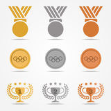 Gold silver bronze medal and trophies Olive wreath (solid color)  set design   Royalty Free Stock Images