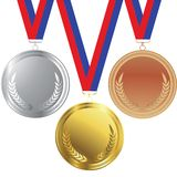 Gold, silver and bronze medals Stock Photos