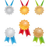Gold, silver and bronze medals. A set of shiny gold, silver and bronze medals over white background Stock Photo