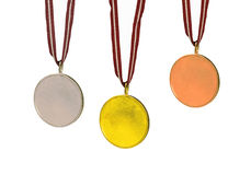 Gold, Silver and Bronze medals. Sets of medals (Gold, Silver and Bronze). All are isolated on white, the center of each is blank for you to fill in Royalty Free Stock Photo