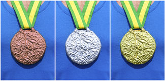 Gold Silver Bronze Medals on Athlete Royalty Free Stock Photos
