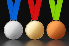 Gold, Silver and Bronze Medals. On a black background Royalty Free Stock Photos