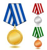 Gold, silver and bronze medals on patterned color Stock Photos